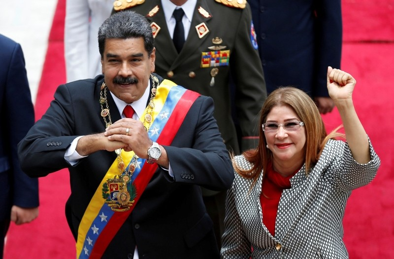 In this May 24, 2018 file photo, Venezuela's President Nicolas Maduro, left, and first lady Cilia Flores, acknowledge the press corps as they arrive for a session with the Constituent Assembly, in Caracas, Venezuela. (AP Photo)
