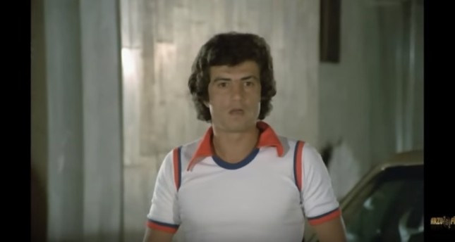 This screen-grab from the movie Aile Şerefi shows the antagonist character Oktay portrayed by actor Eriş Akman.