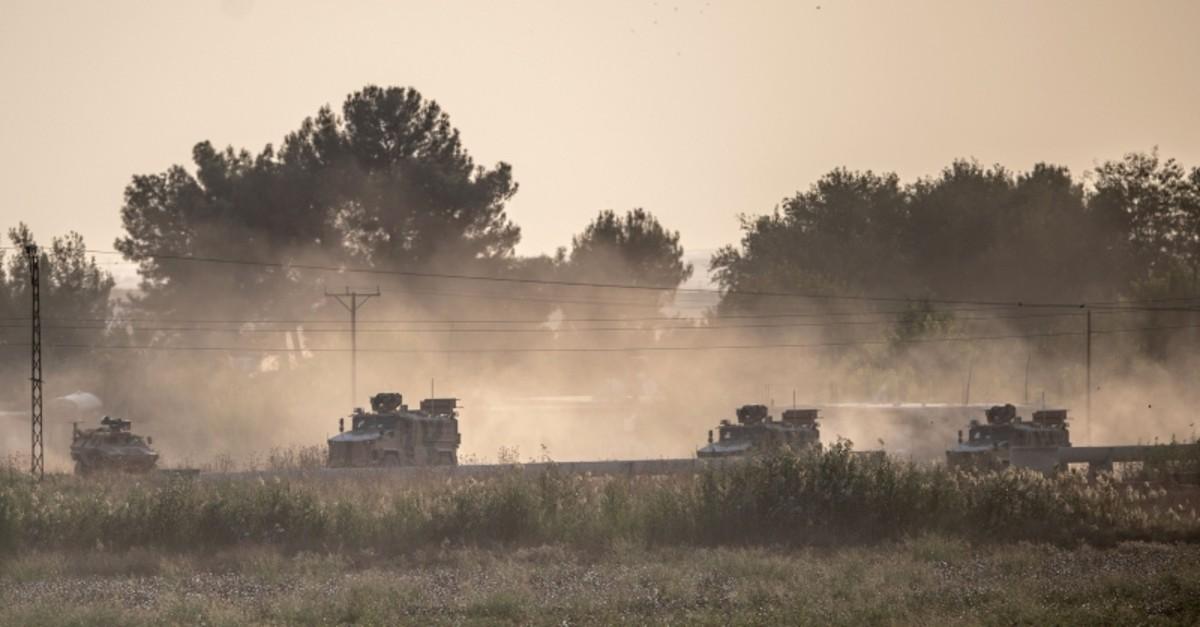 Turkish army vehicles drive toward the Syrian border near Aku00e7akale in southeastern u015eanlu0131urfa province, Oct. 9, 2019. (AFP Photo)