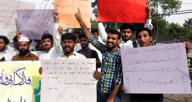 Pakistani students shout slogans to condemn a cartoon contest planned by Geert Wilders, a Dutch parliamentarian, in Lahore, Pakistan, Aug. 28, 2018. (AP Photo)
