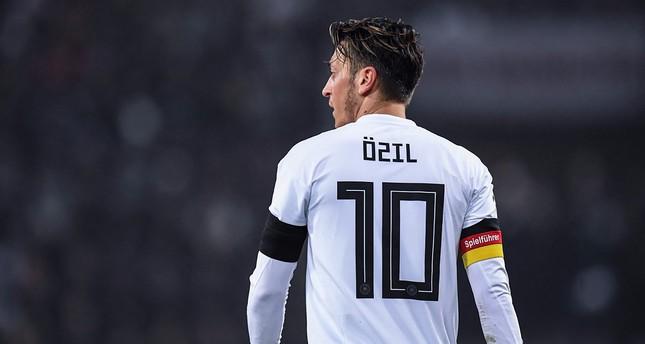 Mesut Özil shows red card to Germany's anti-Turkish football lobby