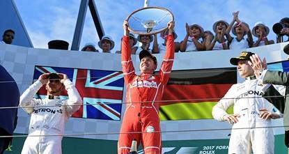 pFour-times world champion Sebastian Vettel won the Australian Grand Prix for Ferrari on Sunday to dash Mercedes' hopes of extending their dominance into a fourth successive season of Formula...