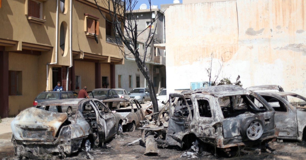 Vehicles damaged by an overnight shelling, Tripoli, April 17, 2019.