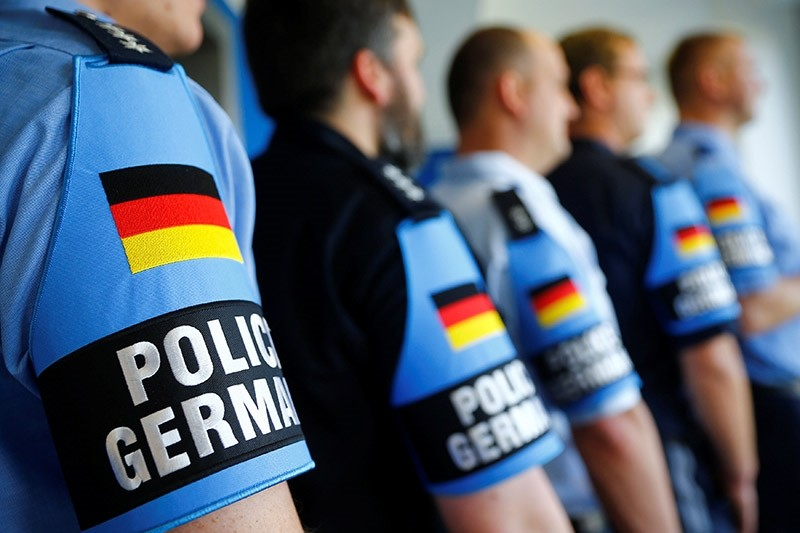 German police officers pose for an image with their armband reading ,Police Germany, at the North Rhine-Westphalian police headquarters in Duisburg, Germany, June 6, 2016. (Reuters Photo)
