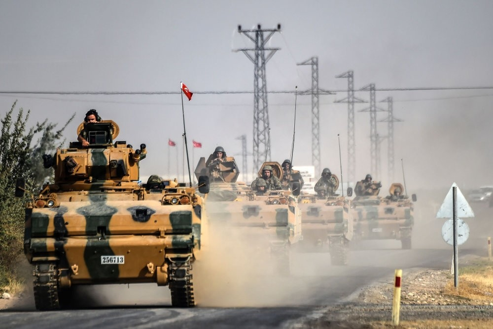 Turkish Army tanks driving to Jarabulus, a Syrian town on the Turkish border, 5 kilometers west of the Turkish border city of Karkamis in the southern region of Gaziantep, Aug. 25, 2016.