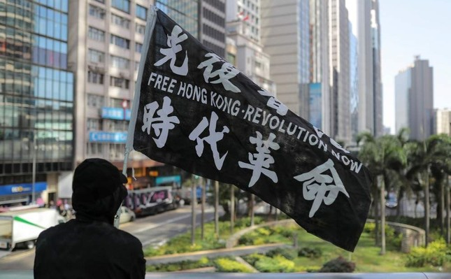 A man holds a flag during a lunchtime protest in Hong Kong, China, Nov. 28, 2019. (Reuters Photo)
