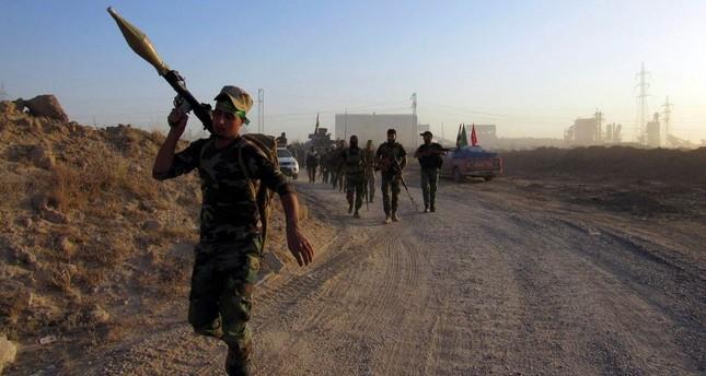 Iraqi Shiite militiamen are accused of killing Sunnis as the sectarian rift is escalates in Iraq.