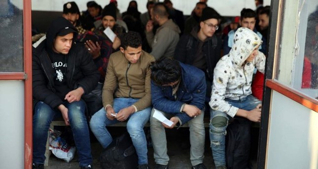 A group of illegal migrants wait for bureaucratic procedures after they were intercepted, Edirne, Dec. 25, 2019 AA Photo