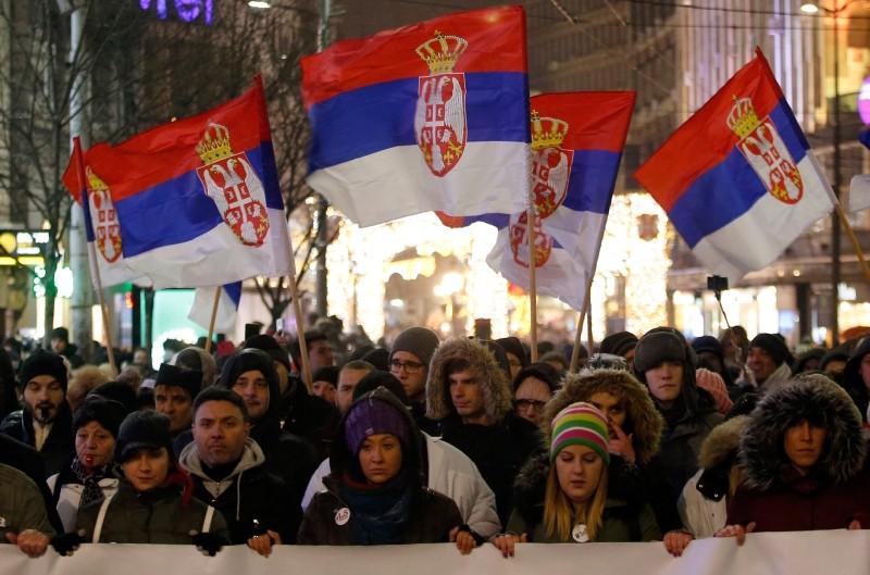 People march during a protest against populist President Aleksandar Vucic in Belgrade, Serbia, Saturday, Jan. 5, 2019. (AP Photo)