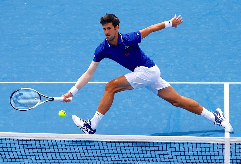 Serbia's Novak Djokovic stretches for a shot during his match against Austria's Dominic Thiem at the Kooyong Classic in Melbourne, Australia, Jan. 10, 2018. (Reuters Photo)