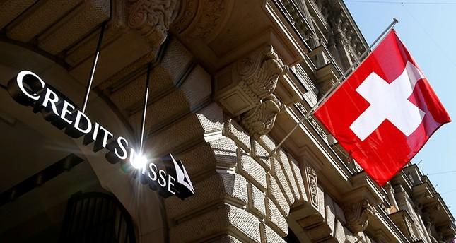 Switzerland's national flag flies beside the logo of Swiss bank Credit Suisse in Zurich, Switzerland April 24, 2017. (Reuters Photo)