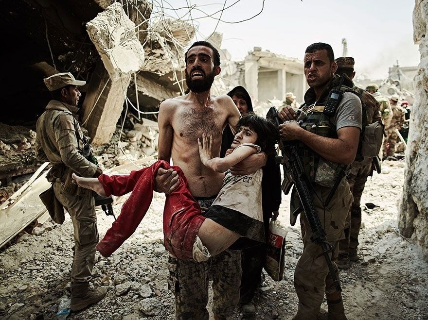 Man Carries Injured Son, Iraq  - 1st place, Journeys and Adventures