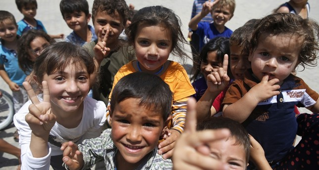 Children play at a Syrian refugee camp in Öncüpınar in southeastern Turkey. Turkey hosts the largest number of refugees from the war-torn country.