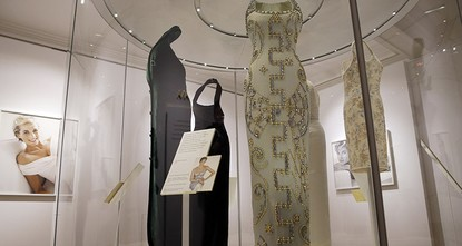 pGowns worn by Princess Diana for everything from meeting diplomats to dancing with movie stars feature in an exhibition celebrating the fashion of one of Britain's favorite royals, which opens in...
