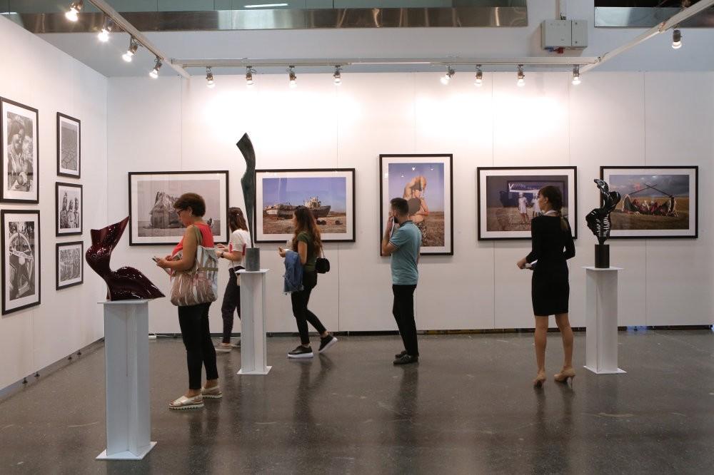 People visit an exhibition at the Contemporary Istanbul art fair, u015eiu015fli, Istanbul.