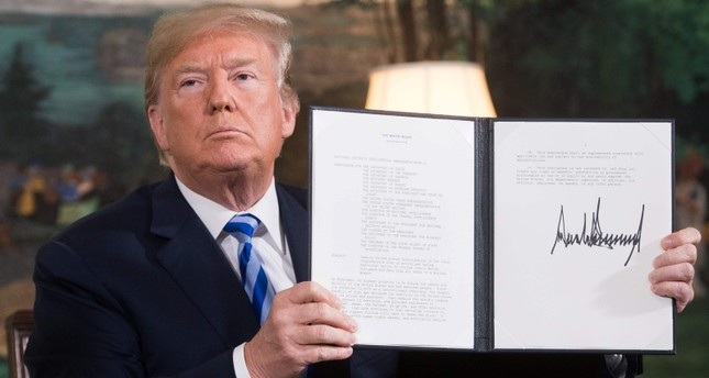 In this file photo taken on May 8, 2018 Trump signs a document reinstating sanctions against Iran after announcing the US withdrawal from the Iran Nuclear deal, in the Diplomatic Reception Room at the White House in Washington. AFP Photo