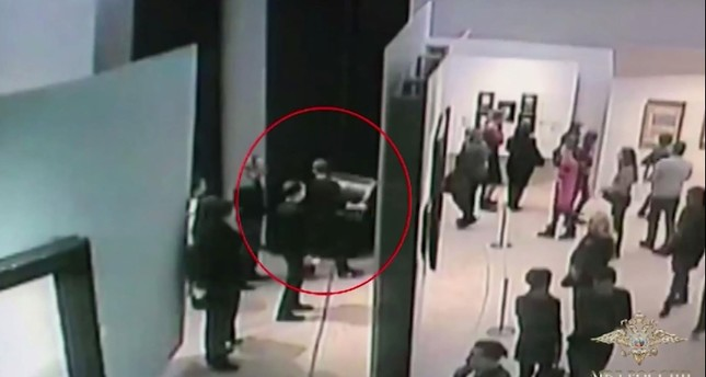 An image grab taken from a video footage released by the Russian Interior Ministry on January 28, 2018, shows a man, stealing a famous painting (AFP Photo)