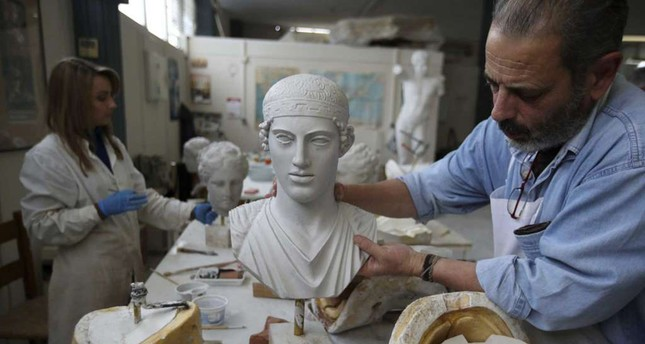 Artists working for the Athen's Culture Ministry are emulating ancient works to sale them in Greek museum shops.