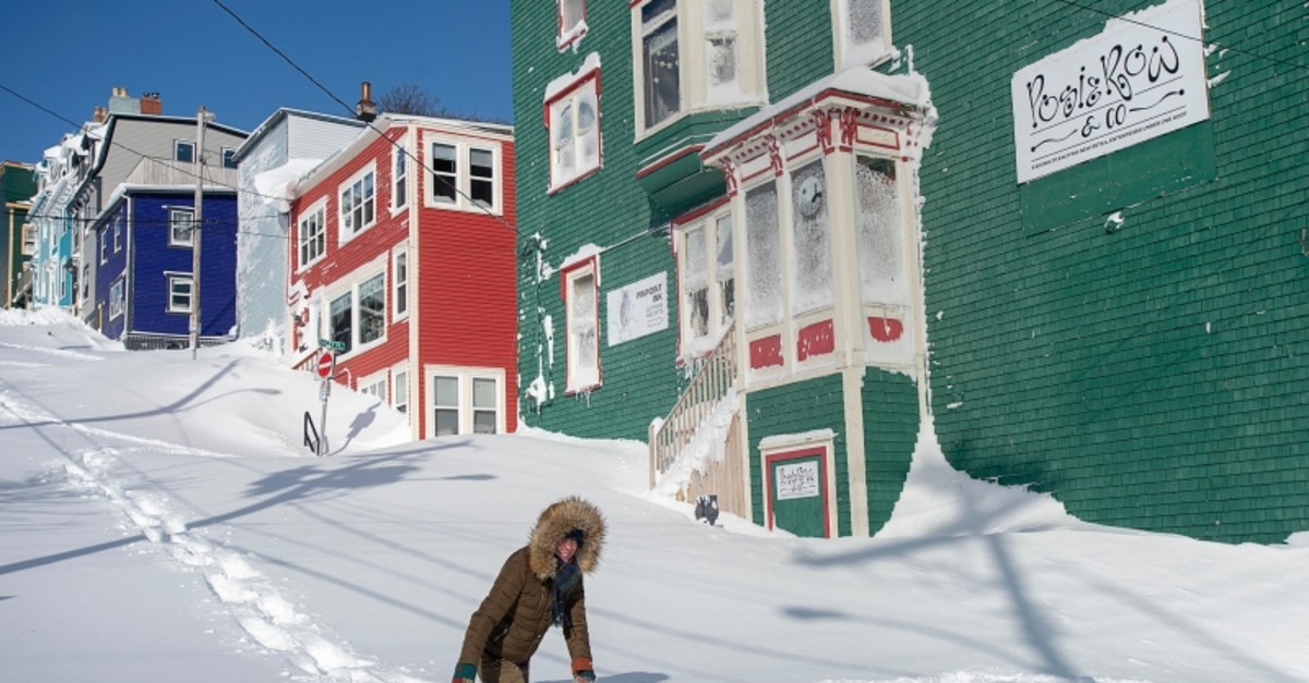 A residents makes their way through the snow in St. John's, Newfoundland on Saturday, Jan. 18, 2020. (Andrew Vaughan/The Canadian Press via AP)