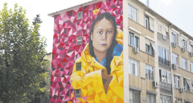 The mural of Greta Thunberg was painted by  Portuguese mural artists Mr. Dheo and Pariz One.