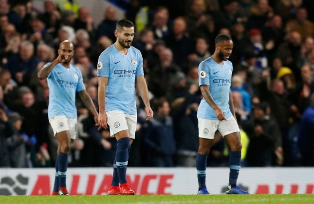 Manchester City players Fabian Delph (R), Raheem Sterling (L) and Ilkay Gundogan (C) react after Chelsea scored their second goal during an English Premier League football match at Stamford Bridge in London, Dec. 8, 2018. (AFP Photo)