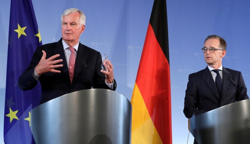 German Foreign Minister Heiko Maas, right, and the European Union chief Brexit negotiator, Michel Barnier, left, address the media during a joint press conference in Berlin, Germany, Wednesday, Aug. 29, 2018. (AP Photo)