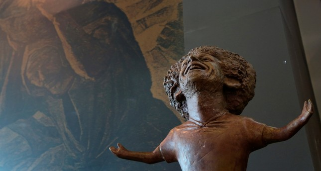 A bronze statue of Liverpool striker Mohammed Salah is on display in a conference hall at an international youths gathering, in Sharm El Sheikh, Egypt, Monday, Nov. 5, 2018. (AP Photo)