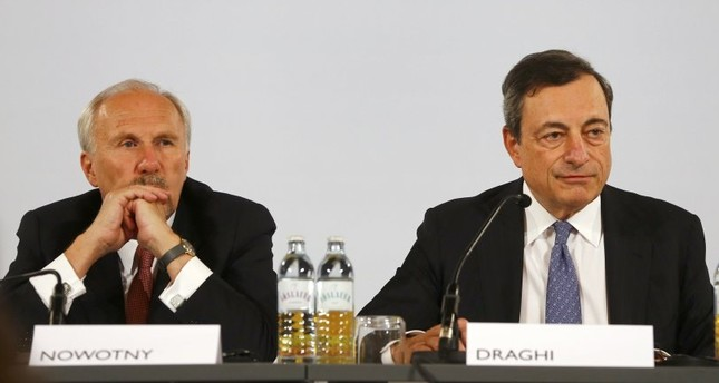 Governor of the Austrian National Bank And European Central Bank ECB Governing Council Member Nowotny L and ECB Governor Draghi at a news conference in Hofburg Palace in Vienna, Austria on June 2.