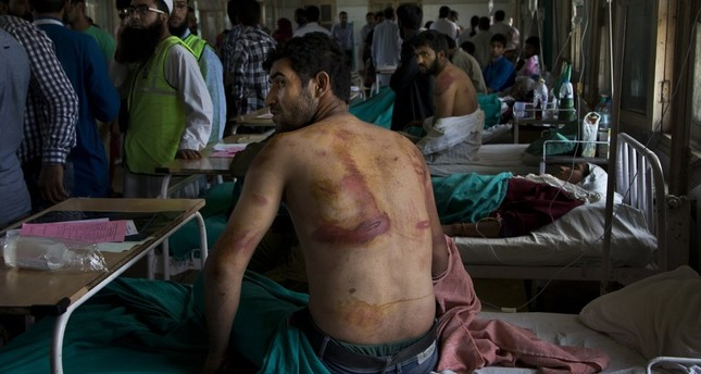 In this Aug. 18, 2016 file photo, Sameer Ahmed, a Kashmiri man allegedly beaten up by Indian soldiers at Khrew village, recovers at a local hospital in Srinagar, Indian controlled Kashmir. AP Photo