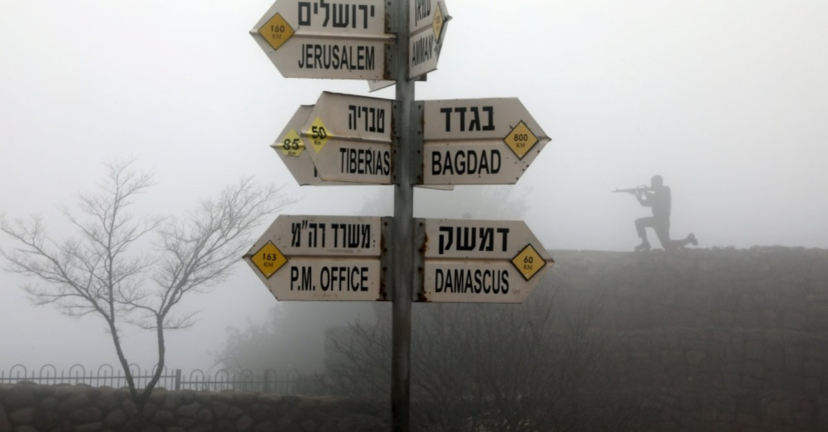 Signs pointing to distances of different cities seen at Mt. Bental, an observation post in the Israeli-occupied Golan Heights, March 25, 2019.