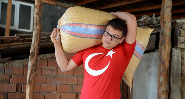 Gökhan Taşpınar carried a countless number sacks, filled to the brim with hazelnuts which helped build up his body.
