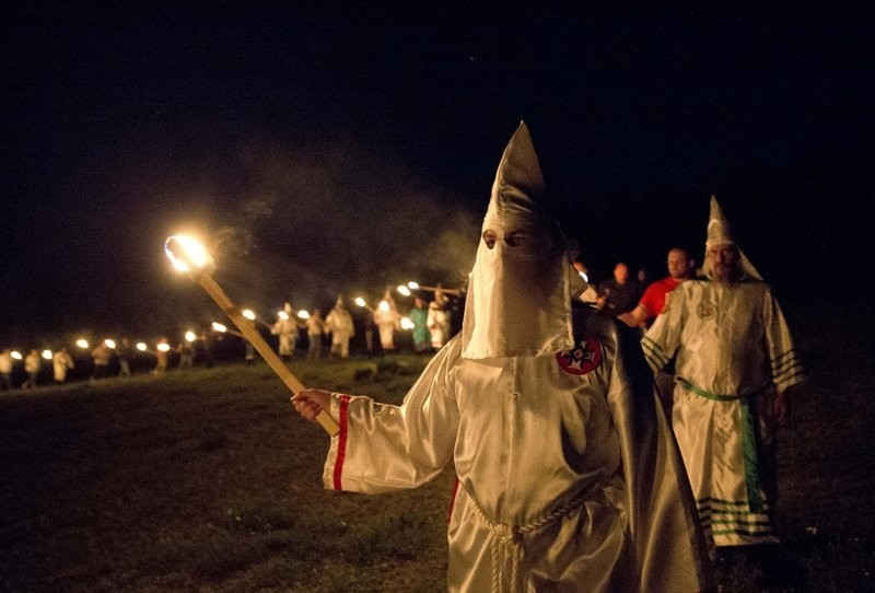 In this Saturday, April 23, 2016 photo, members of the Ku Klux Klan participate in cross burnings after a ,white pride, rally in rural Paulding County near Cedar Town, Ga. (AP Photo)