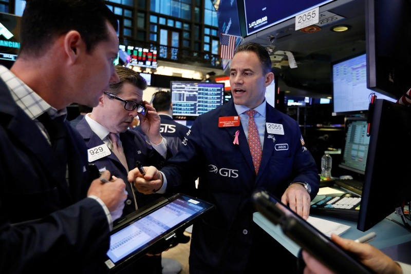 Specialist Jason Hardzewicz, right, works on the floor of the New York Stock Exchange, Wednesday, Oct. 24, 2018. (AP Photo)