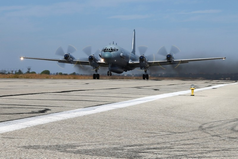 In this photo taken on Thursday, Nov. 12, 2015, a Il-20 electronic intelligence plane of the Russian air force takes off from the Russian air base in Hemeimeem, Syria. (AP Photo)
