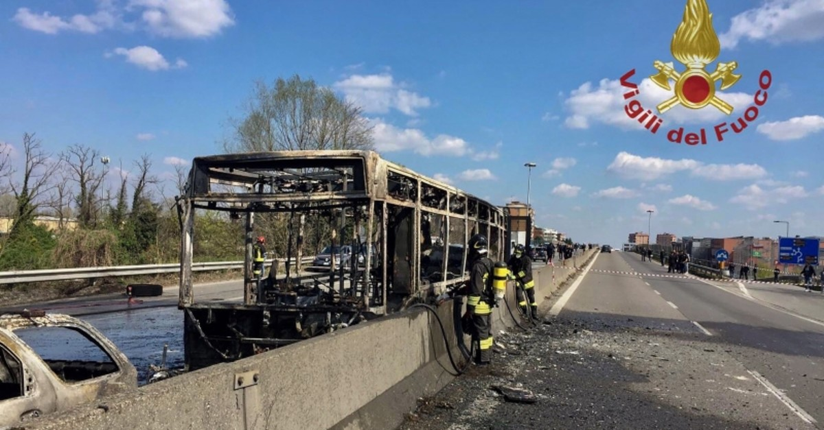 This handout picture taken and released by the Vigili del Fuoco, the Italian fire and rescue service, on March 20, 2019 shows the wreckage of a school bus after it was torched by the bus' driver, in San Donato. (AFP Photo)
