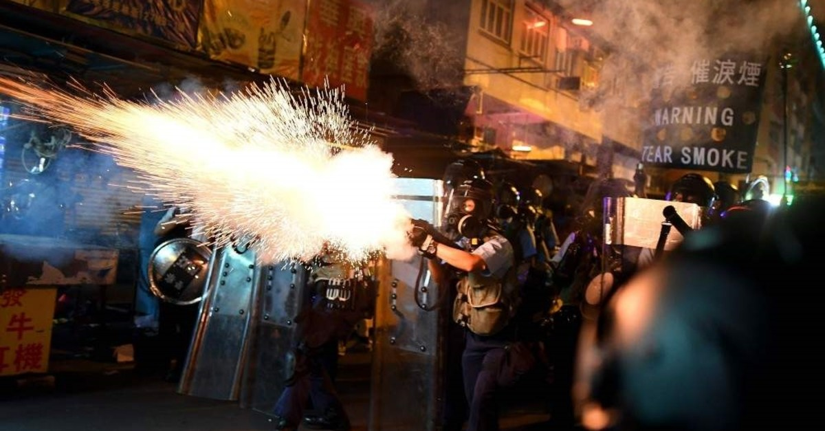 Police fire tear gas shells to disperse protestors, Hong Kong, Aug. 14, 2019. (AFP Photo)
