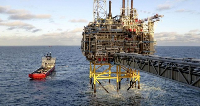 Norway's wealth fund, which reached $1 trillion in size, divests from energy firms which violate its ethical principles for environment, human rights and governance.