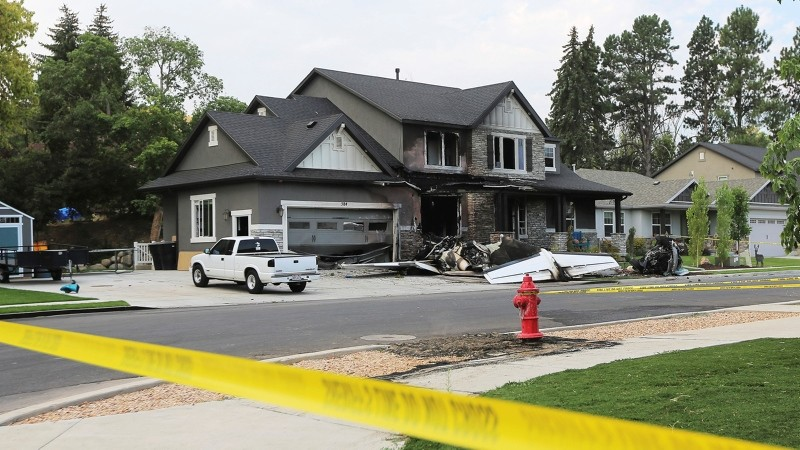 The scene of a small plane that crashed into a house in Payson, Utah, on Aug 13, 2018. (AP Photo)
