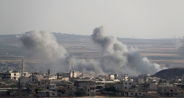 This picture taken on Aug. 5, 2019, shows smoke billowing above buildings during a reported air strike by pro-regime forces on Khan Sheikhun in the south of the northwestern Syrian province of Idlib. AFP Photo