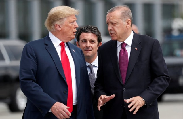 President Recep Tayyip Erdoğan gestures as he talks with U.S. President Donald Trump at the start of the NATO summit in Brussels, July 11.