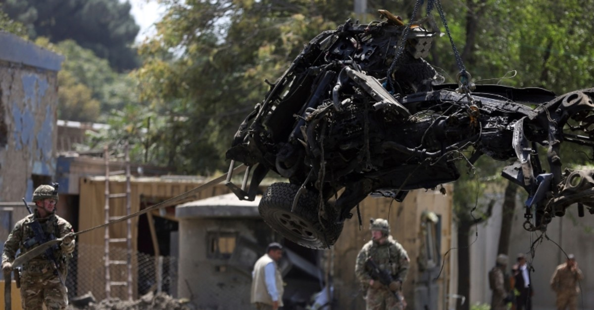 Resolute Support (RS) forces remove a damaged vehicle after a car bomb explosion in Kabul, Afghanistan, Thursday, Sept. 5, 2019 (AP Photo)