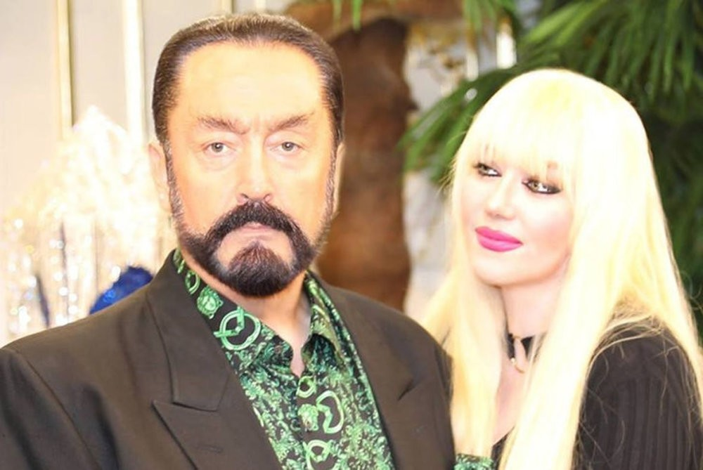 Cult leader Adnan Oktar and one of his female followers whom he addresses as ,kittens, seen together before his arrest on July 11.