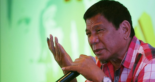 In this Monday, May 9, 2016 photo, front-running presidential candidate Mayor Rodrigo Duterte answers questions from the media during a news conference shortly after voting at his hometown in Davao city in southern Philippines AP Photo
