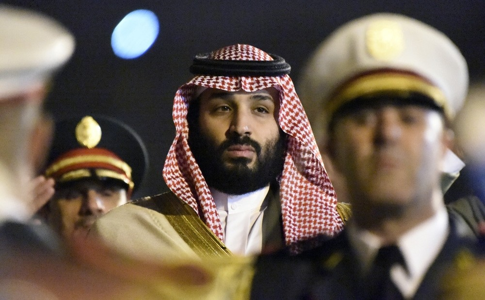 Saudi Crown Prince Mohammed bin Salman is seen behind a military band upon his arrival at Algiers International Airport, southeast of the capital Algiers on Dec. 2.