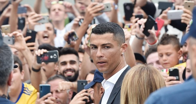 New Juventus soccer player Cristiano Ronaldo (C) of Portugal arrives at Juventus J Medical in Turin, Italy, 16 July 2018. (EPA Photo)