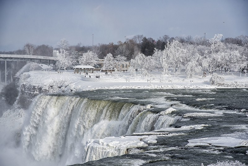 A frozen Niagara Falls is seen in views from Stedman's Bluff on Goat Island of the American Falls and Prospect Point beyond.