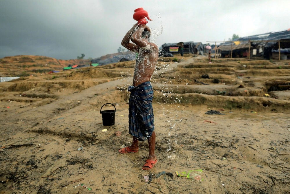 A male Rohingya refugee washes in a refugee camp in the Palong Khali district, Bangladesh, Oct. 12.