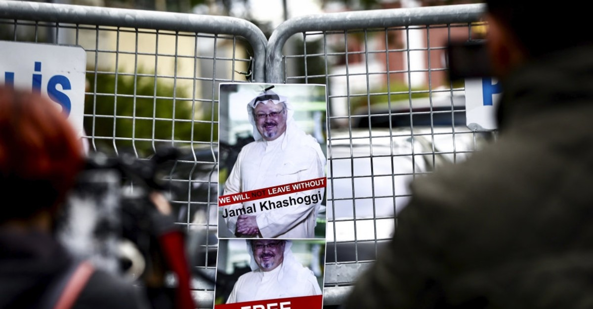 Posters of Jamal Khashoggi on the barricade in front of the Saudi Consulate in Istanbul during a protest, Oct., 14, 2018.