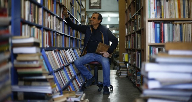 Bookworm develops his own workplace out of used books