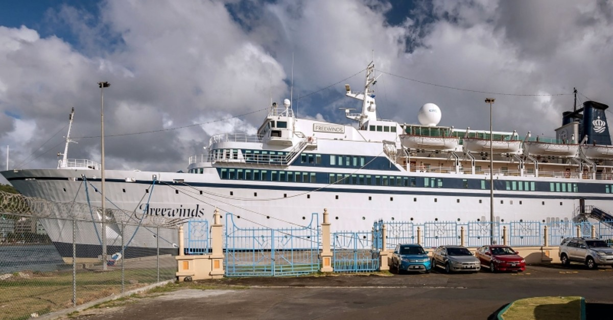The Freewinds cruise ship owned by the Church of Scientology is seen docked in quarantine at the Point Seraphine terminal in Castries, Saint Lucia (AFP Photo)
